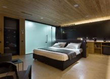 Wooden-and-modern-interior-of-the-Guest-Houses-give-a-warm-shelter-inside-the-pine-forest-217x155