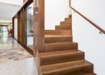 Wooden-stairway-connects-the-lower-living-area-with-the-bedrooms-217x155