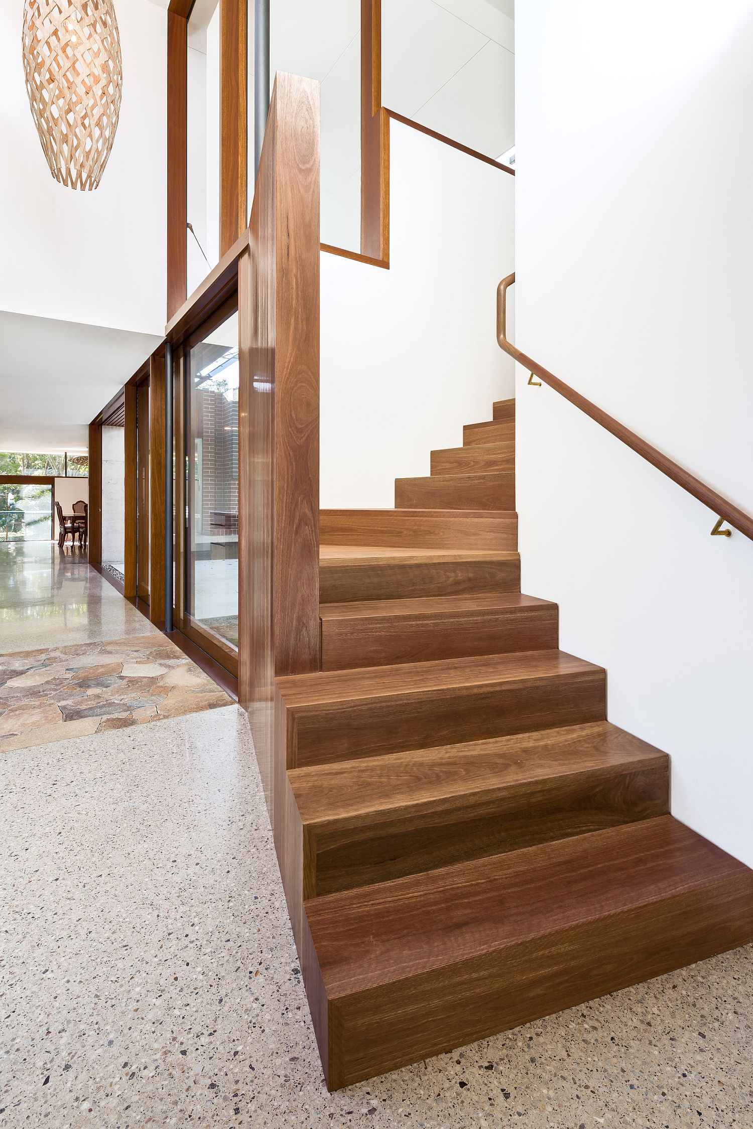 Wooden stairway connects the lower living area with the bedrooms
