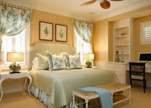 Yellow-tropical-bedroom-with-grasscloth-wallcovering-and-botanical-prints-217x155