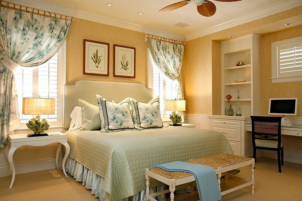 Yellow tropical bedroom with grasscloth wallcovering and botanical prints