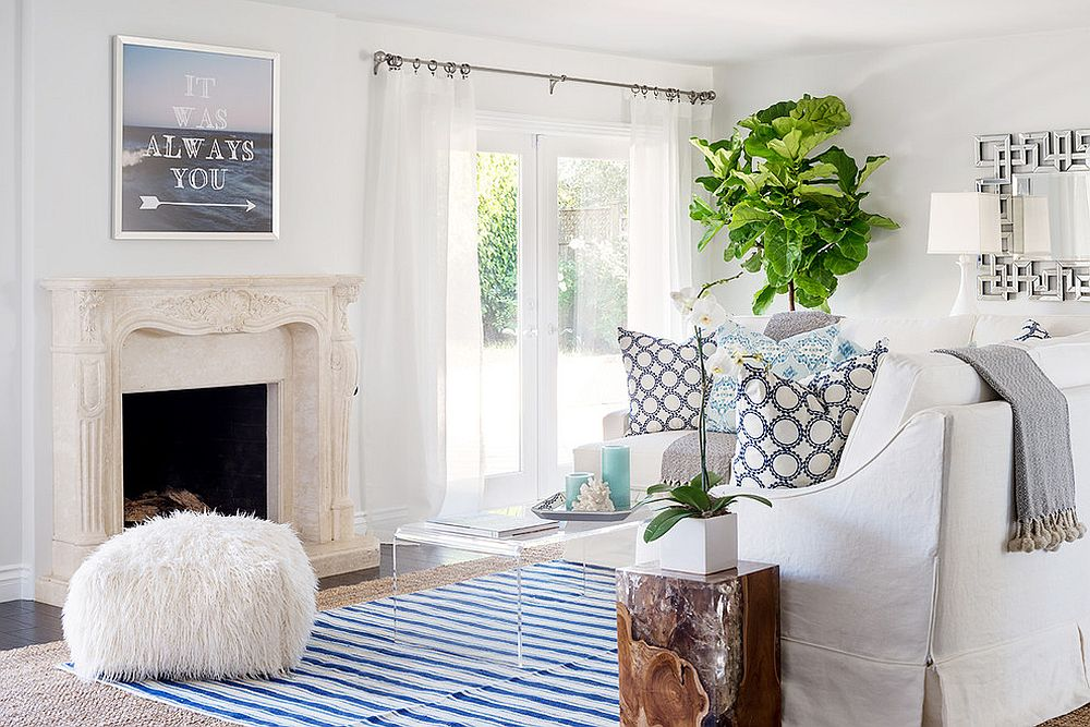 Beach style living room with white sheers that blend into the backdrop