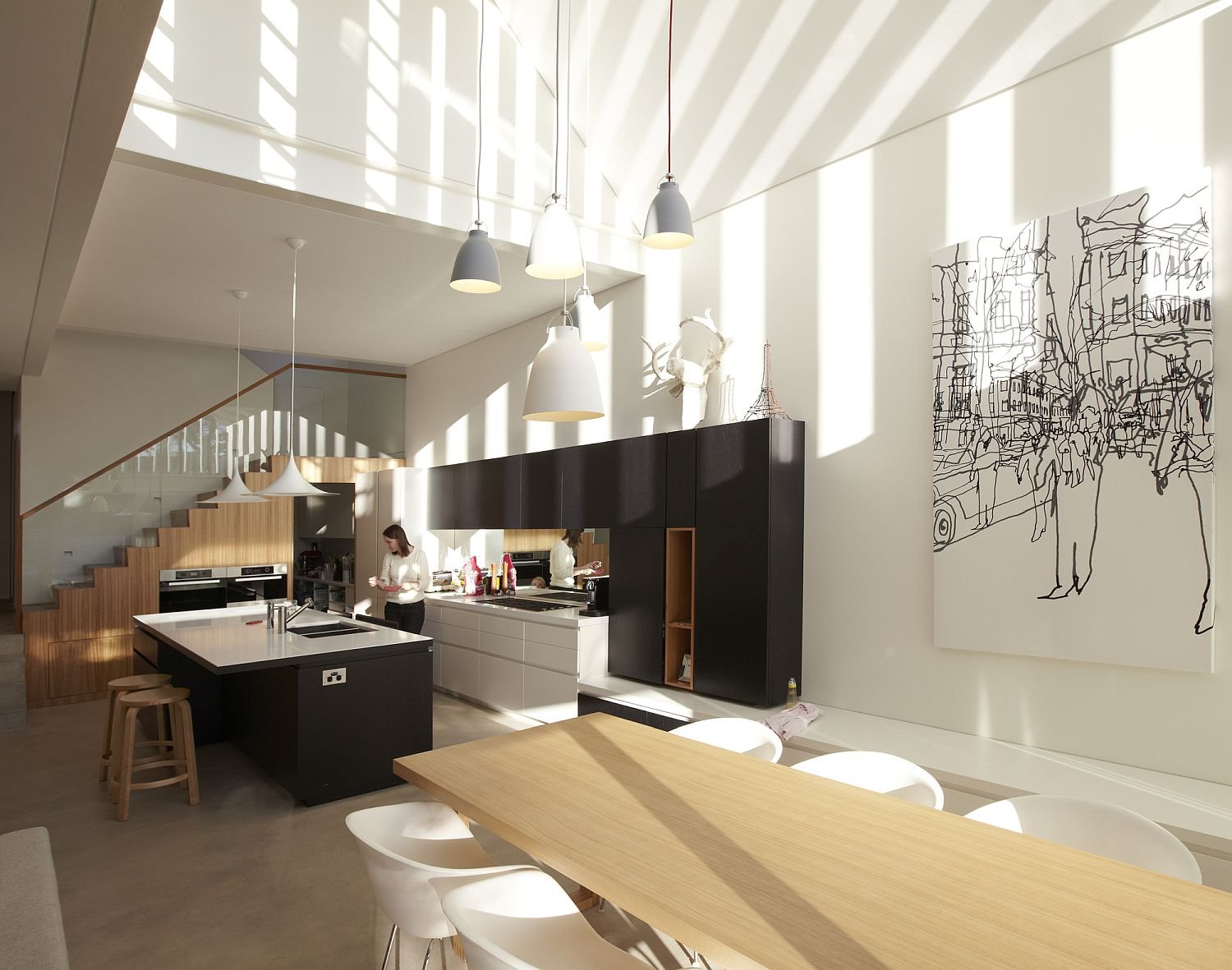Black separates the kitchen from the dining and living space visually