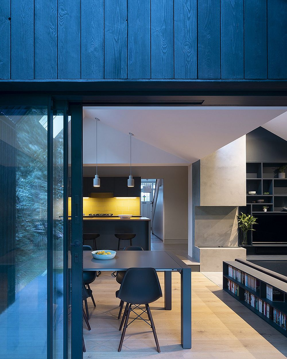 Blue, concrete and wood fashion a unique color palette inside this modern London home