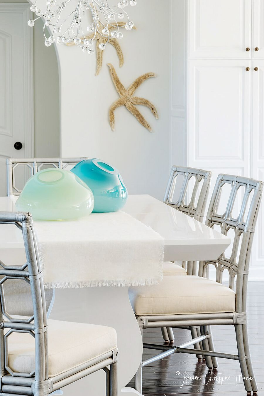 Coastal accents bring uniqueness to the dining space in white