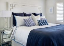 Coastal-style-bedroom-in-deep-blue-and-white-with-lots-of-natural-light-217x155