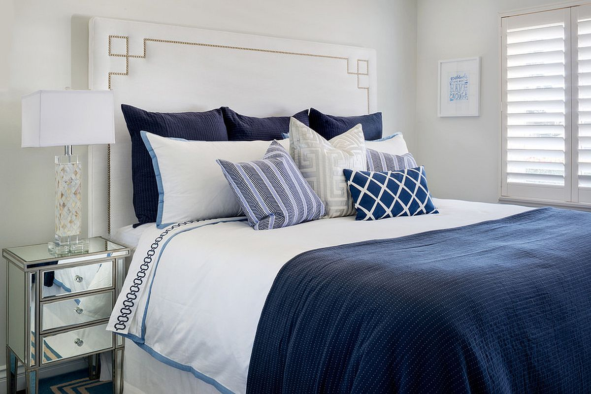 Coastal style bedroom in deep blue and white with lots of natural light