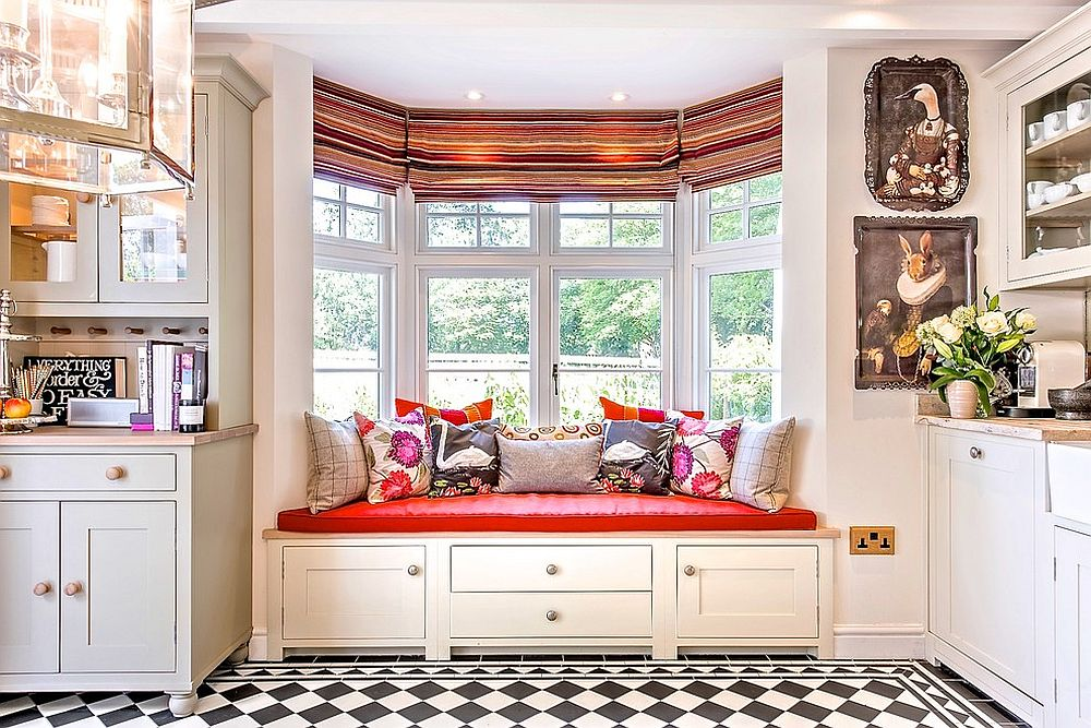 Comfy window seat with colorful cushion adds brightness along with storage to the kitchen