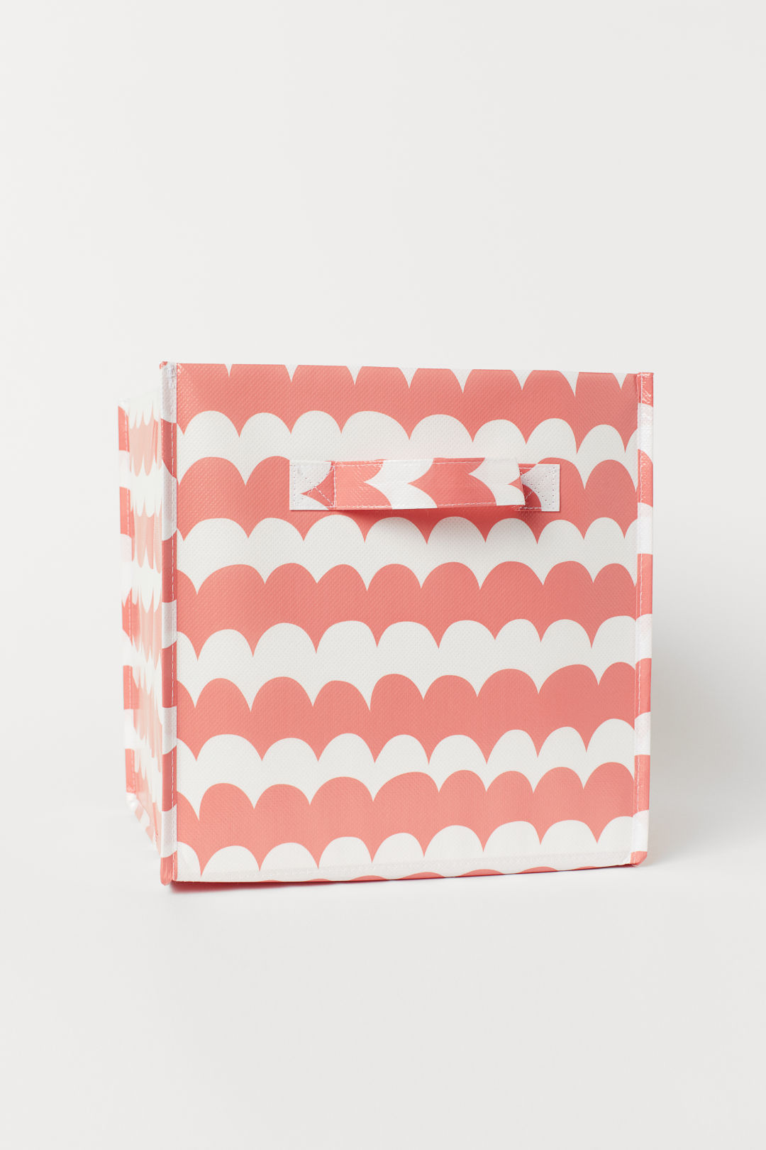Coral and white storage box from H&M