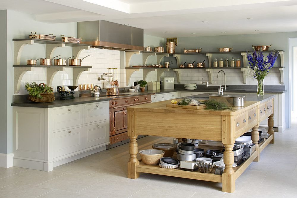 Custom copper and stainless steel range along with dishware make a statement in this kitchen