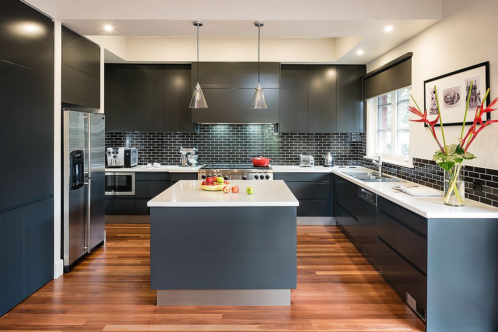 Dark and dashing kitchen in gray with a tiled black backsplash