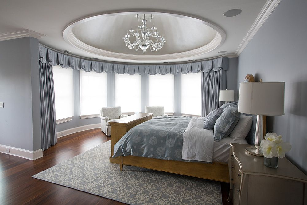 Drapes add both functional and aesthetic value to this circular bedroom