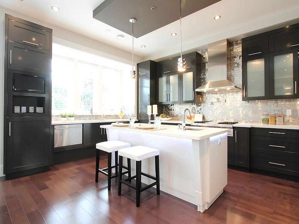 Exquisite metallic backsplash fills the room with light