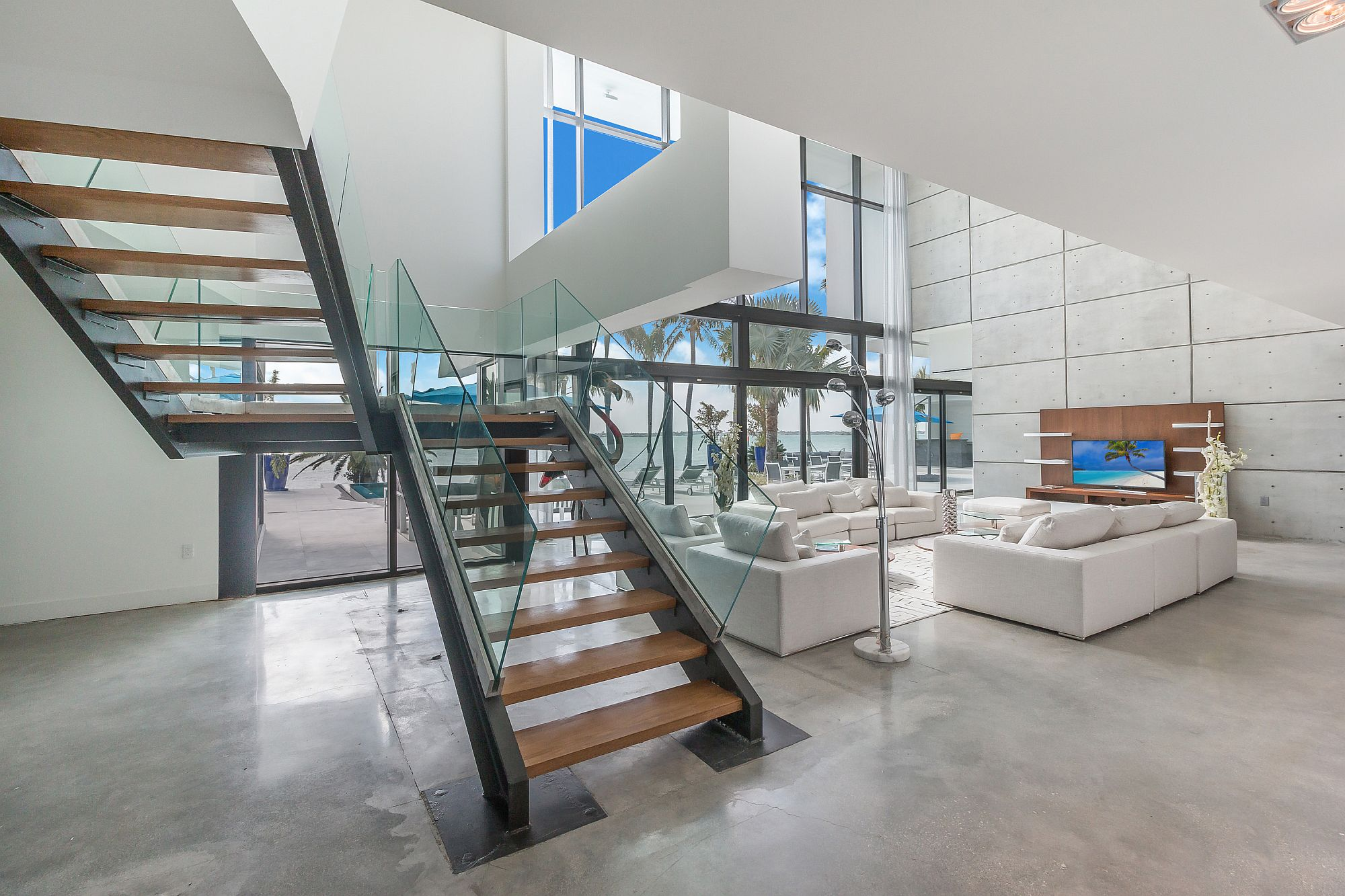 Fabulous staircase connecting different levels of the contemporary Miami home