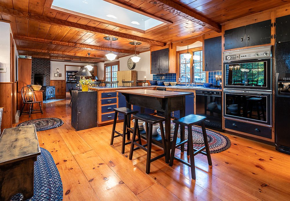Farmhouse kitchen in wood with blue backsplash
