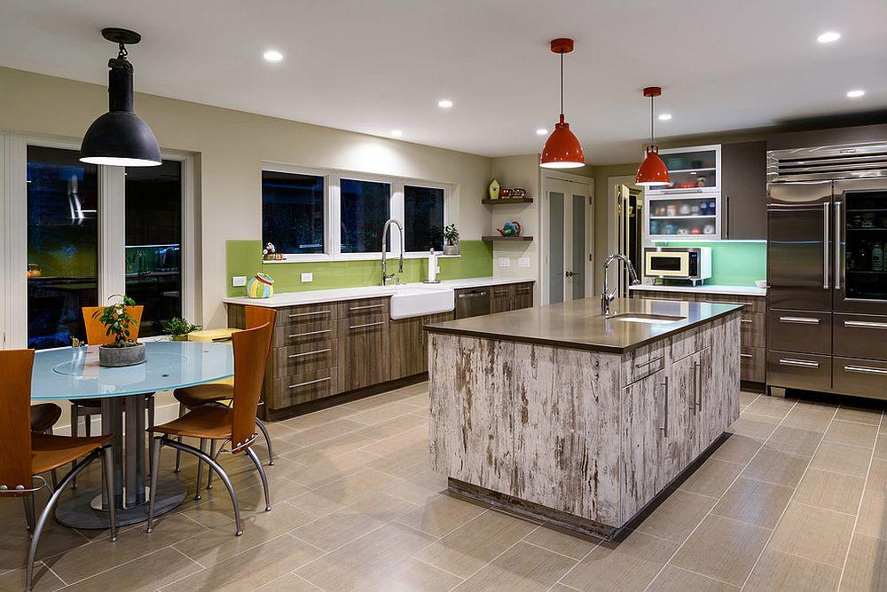 Fun contemporary kitchen with green backsplash and orange pendants