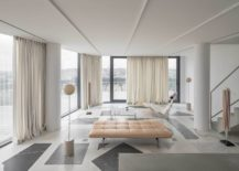 Glass-walls-and-drapes-combined-to-create-a-lovely-ambiance-inside-the-apartment-217x155