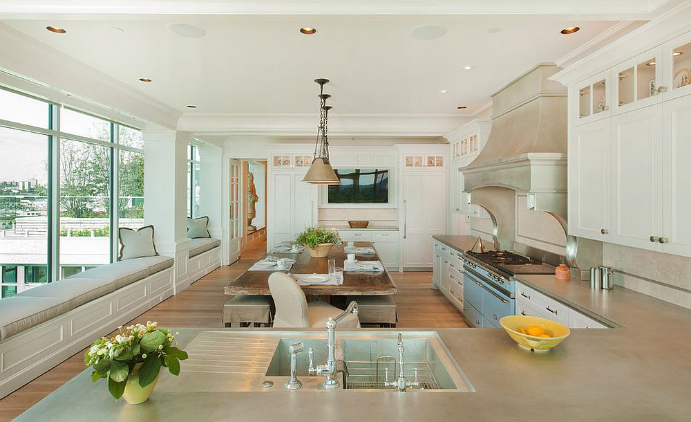 Gorgeous and spacious kitchen and dining with ample window seating is perfect for the large modern family