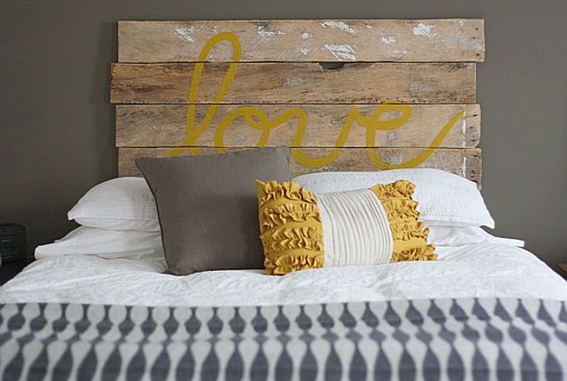 Headboard of this bed spells out LOVE!