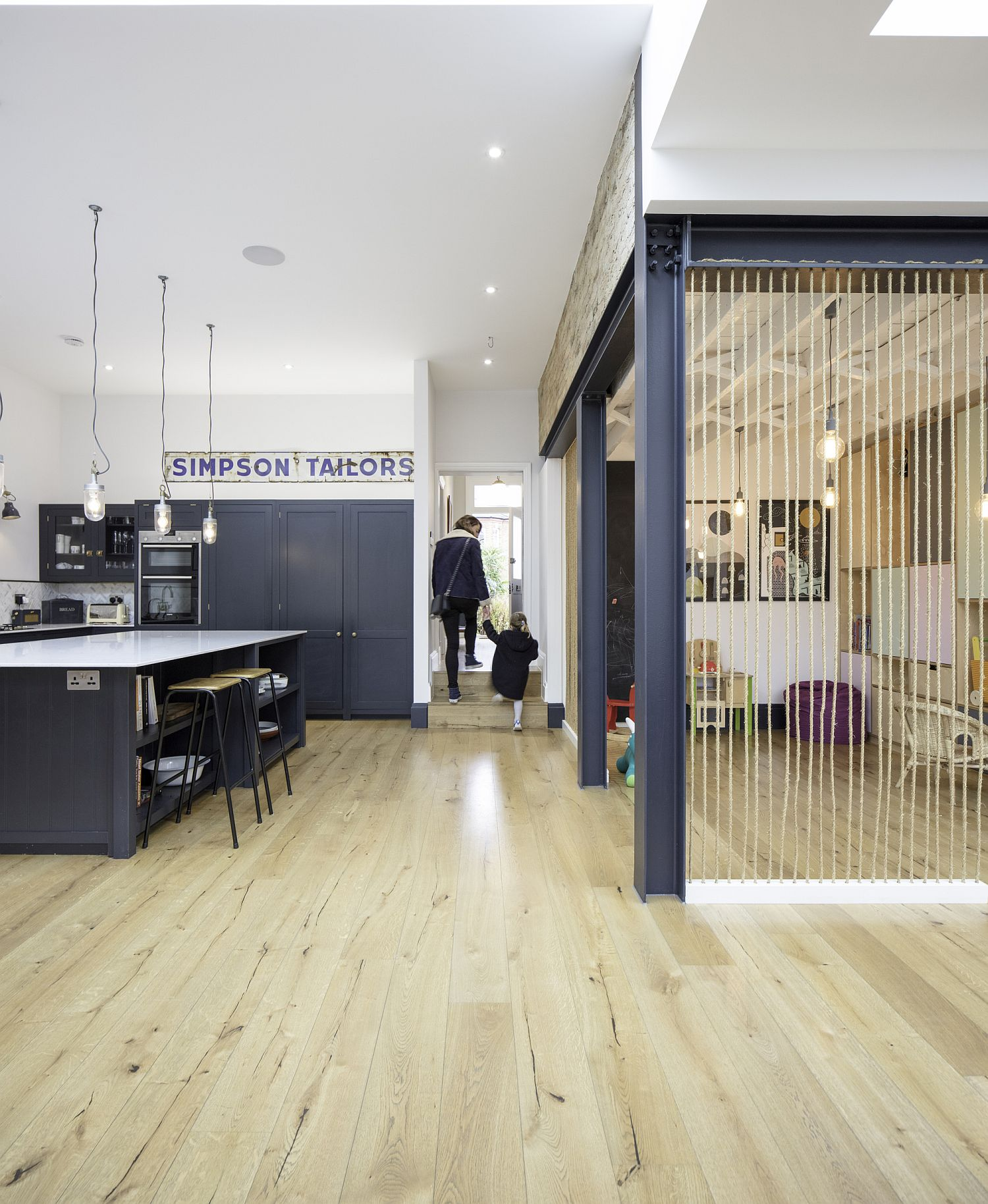 Kitchen of the converted London hom feels like an extension of the living room