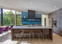 Light-filled-contemporary-kitchen-with-bright-blue-accent-wall-and-backsplash-217x155
