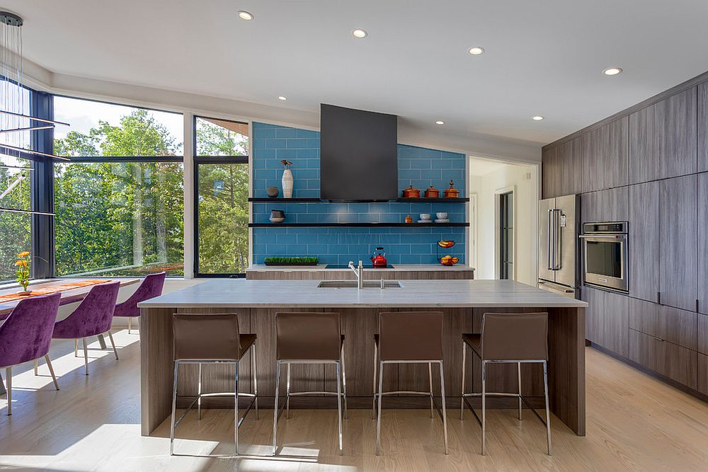 Light-filled contemporary kitchen with bright blue accent wall and backsplash