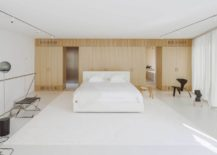 Minimal-bedroom-in-white-with-wooden-accent-wall-217x155