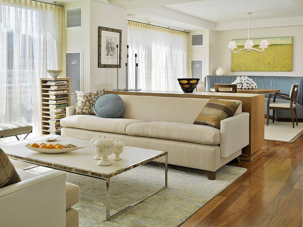 Modern living room with sheers that imbibe a bit of yellow to the setting