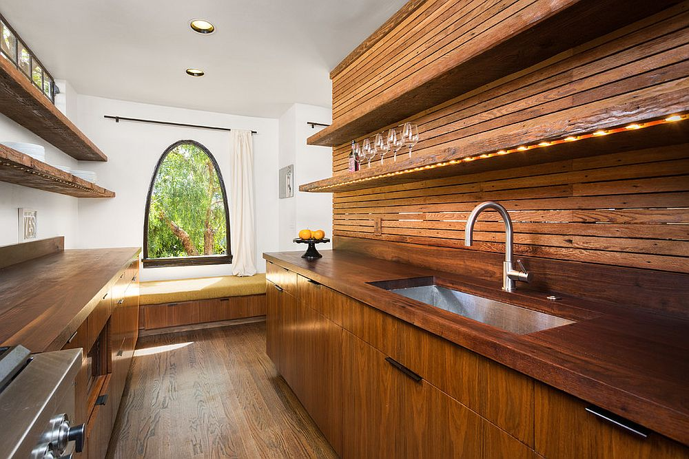 Narrow and woodsy contemporary kitchen with window seat at its end