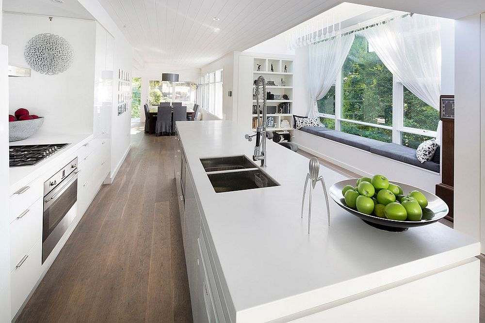 Narrow kitchens with a view are the perfect places for a comfy bay window seat