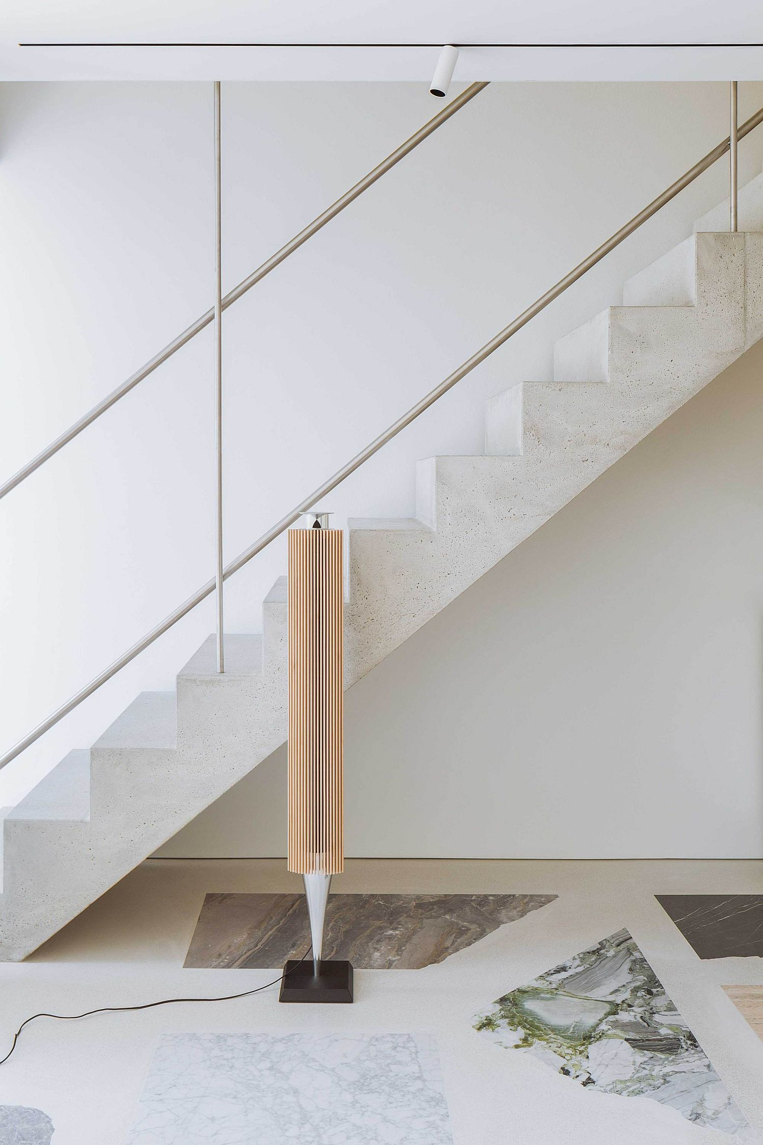 Natural concrete staircase leads to the top level