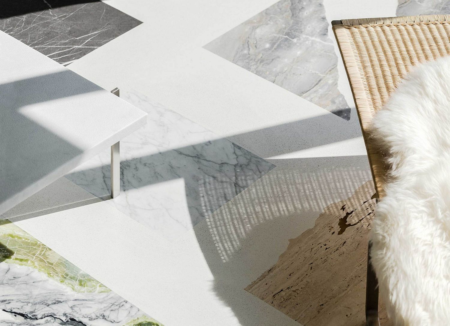 Natural stone tiles create a smart floor that looks like collage of various pieces