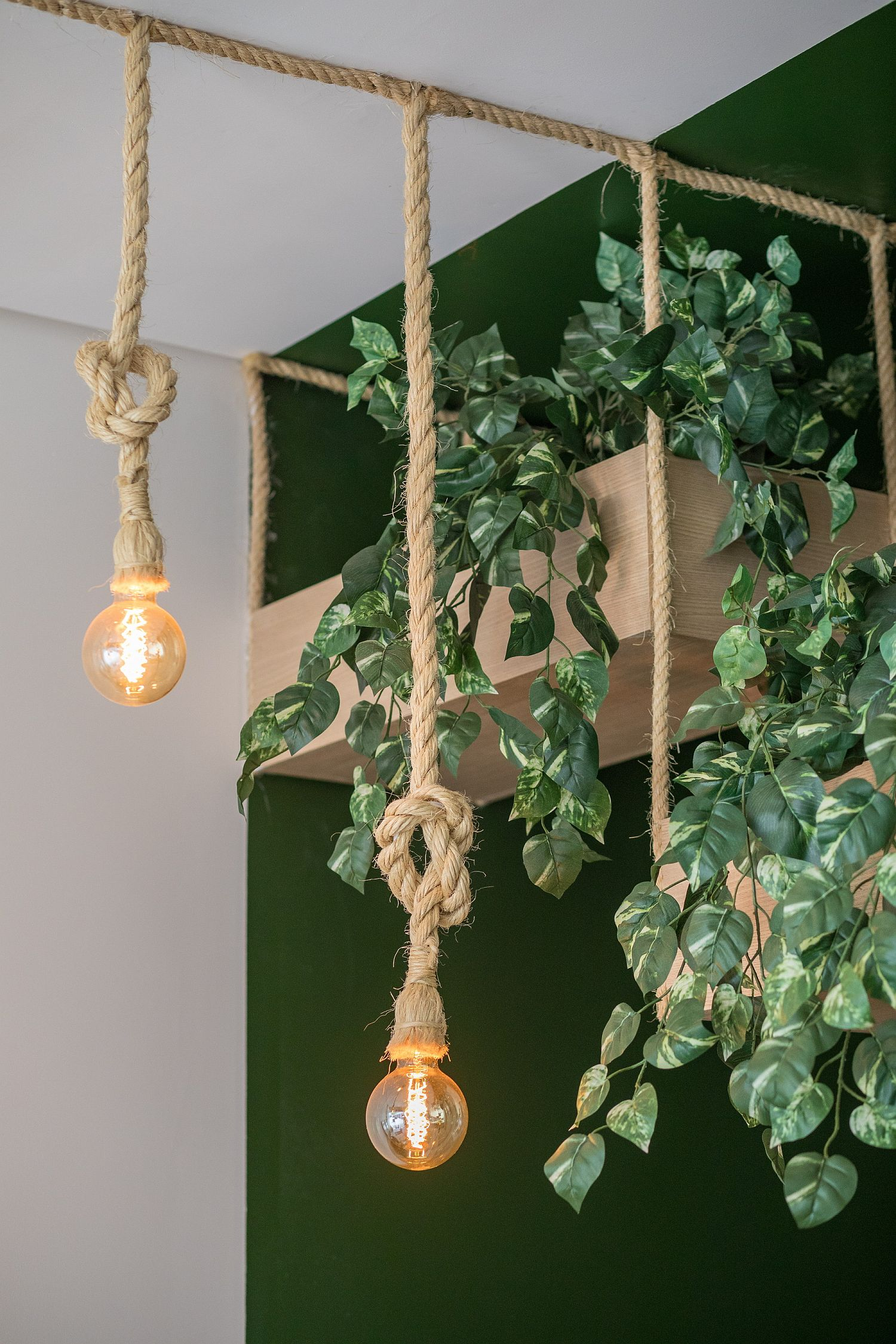Plants, wood and rope reshape the interior of the cafe
