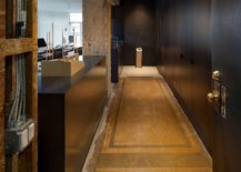 Raw-steel-concrete-and-custom-fixtures-along-with-monolithic-cabinets-for-the-home-office-217x155