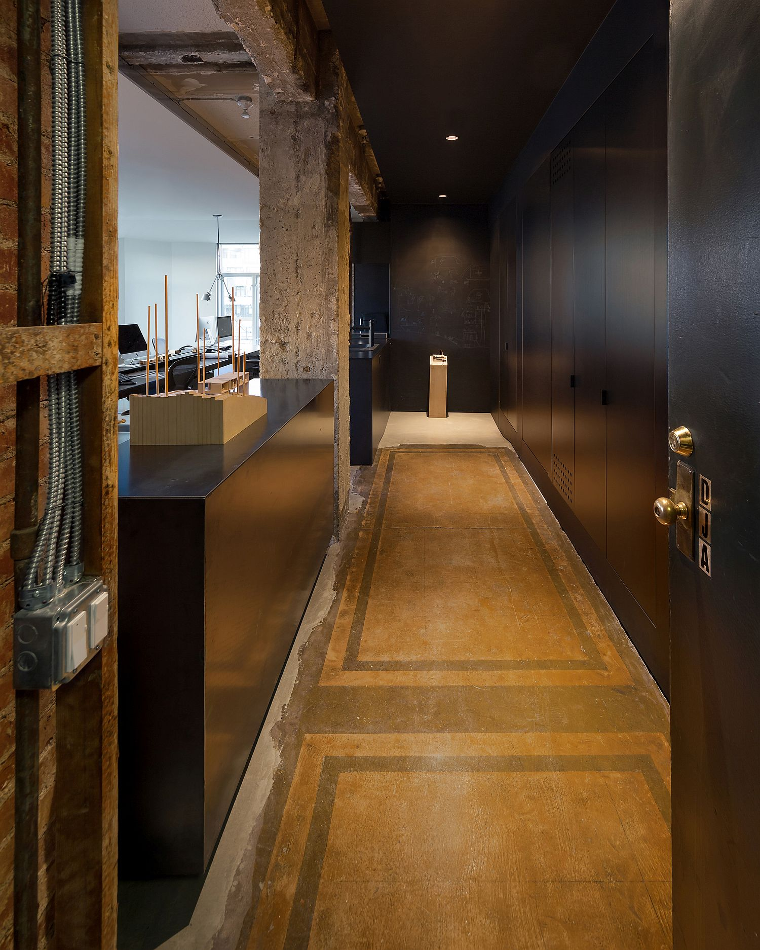 Raw-steel-concrete-and-custom-fixtures-along-with-monolithic-cabinets-for-the-home-office
