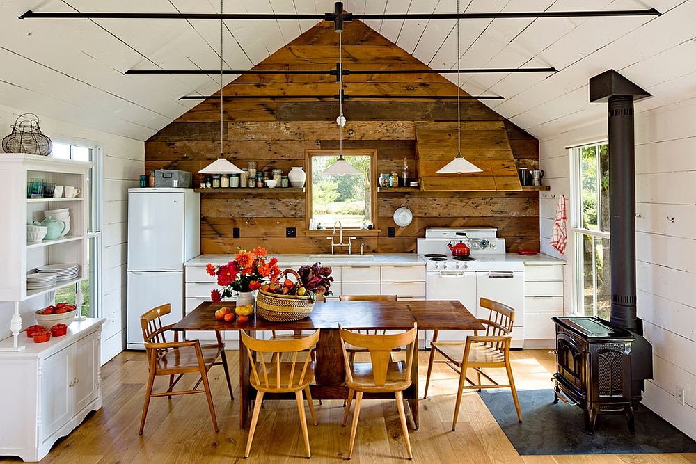Reclaimed wood creates a gorgeous accent wall in the attic farmhouse kitchen