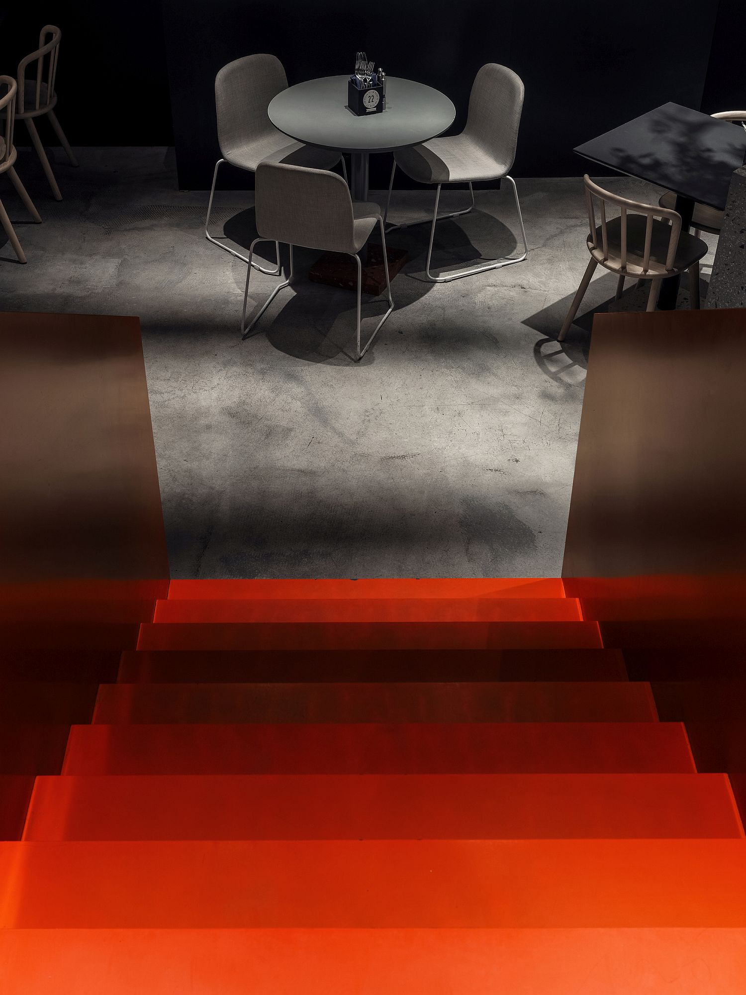 Red stairs leading to the lower level of Pizza 22
