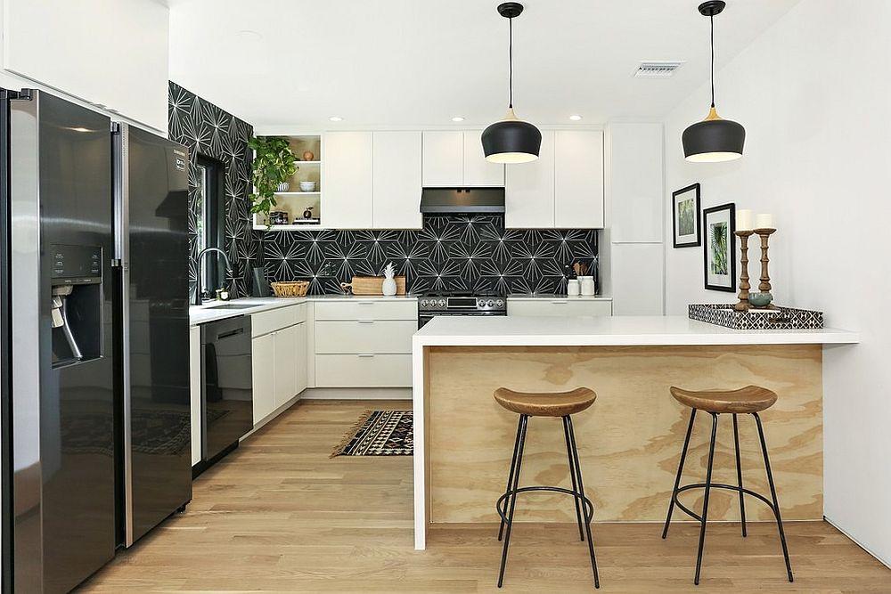 Scandinavian kitchen in white with black backsplash and starry pattern