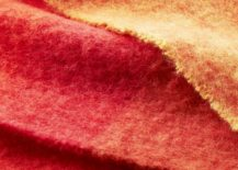 Shades-of-coral-on-an-alpaca-throw-from-CB2-217x155
