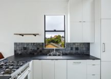 Small-Scandinavian-kitchen-in-white-with-black-counters-and-backsplash-217x155