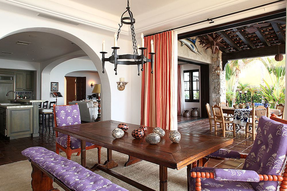 Spacious Mediterranean style dining room with drapes in coral and white