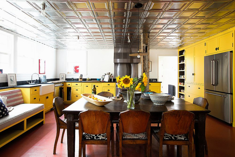 Stunningly colorful kitchen in yellow with a ceiling that also stands out