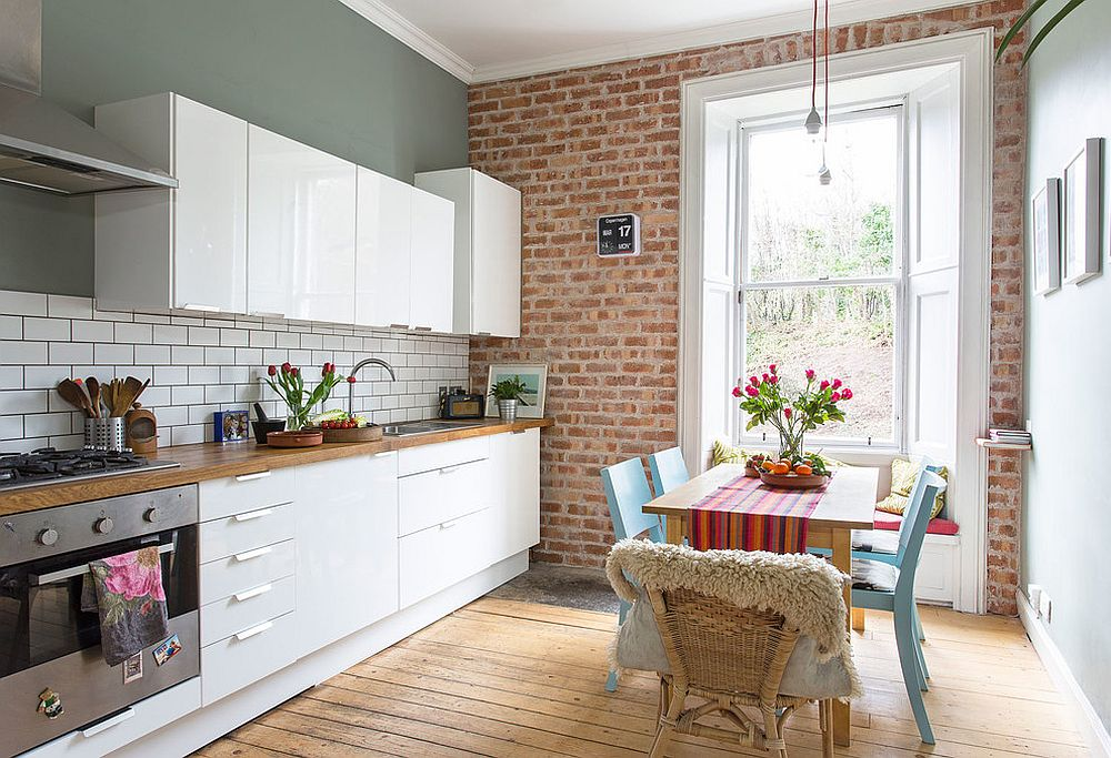 Tiny window seat for the eclectic kitchen with a small dining table