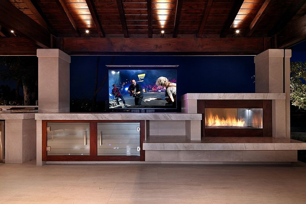Transitional home theater next to the pool