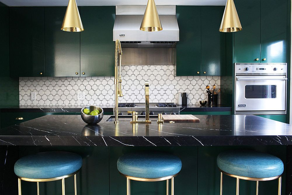 Trio of brass pendants along with kitchen fixtures bring brightness to the space