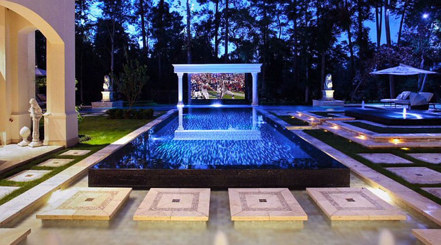 Tropical style home theater outdoors that can be turned into just a pool hangout when needed