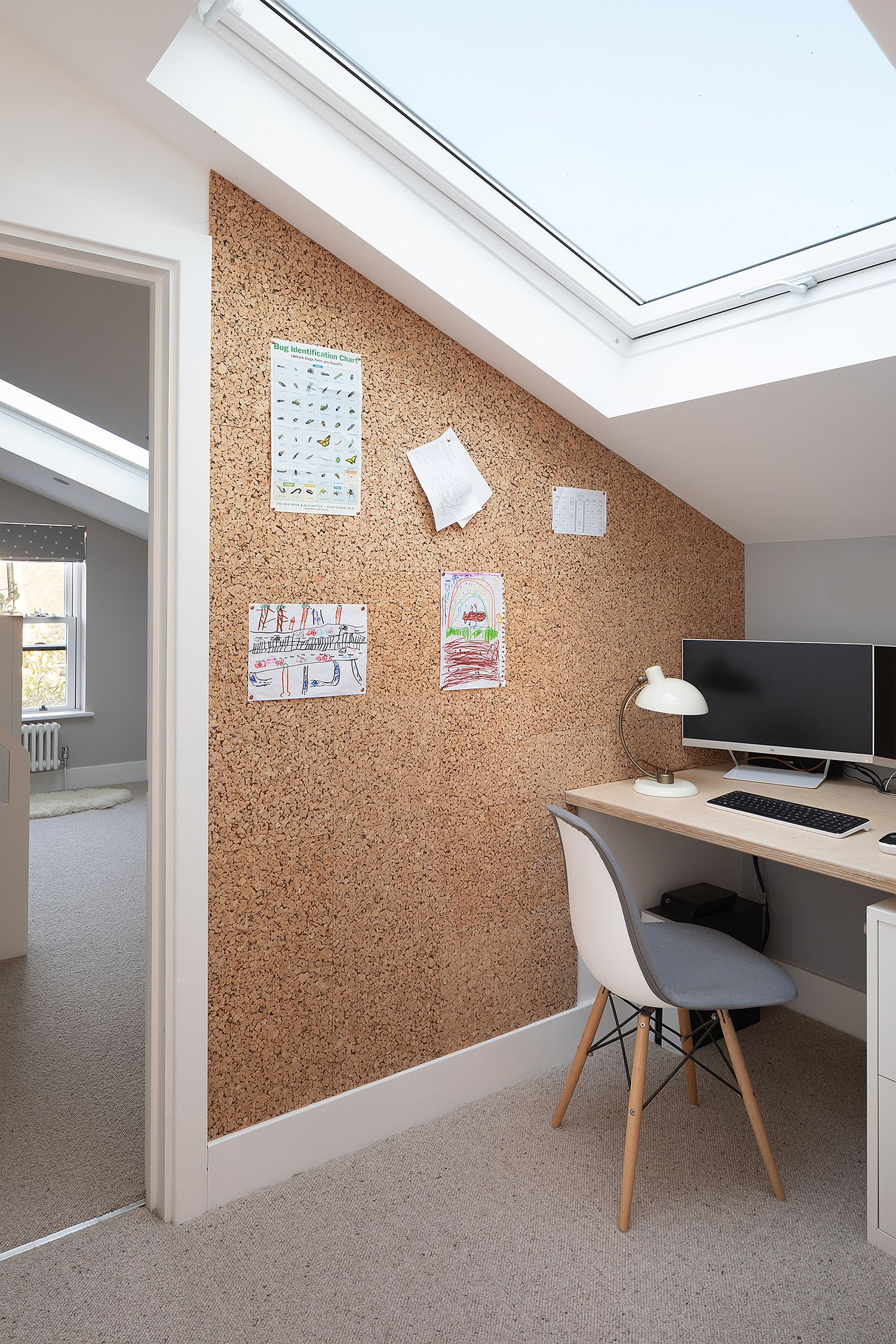 Upper level corner workspace with skylight