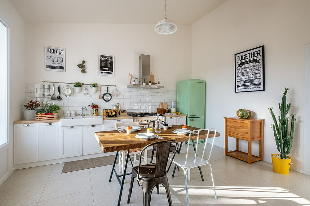 Vintage fridge in the corner adds to the farmhouse appeal of the kitchen in white