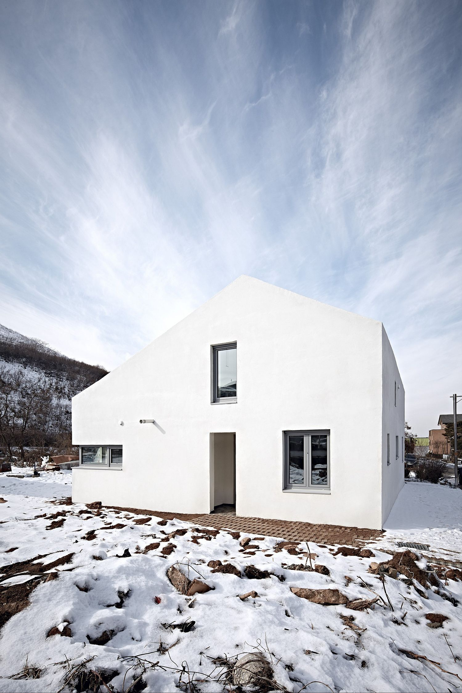 White exterior of the house blends into the backdrop