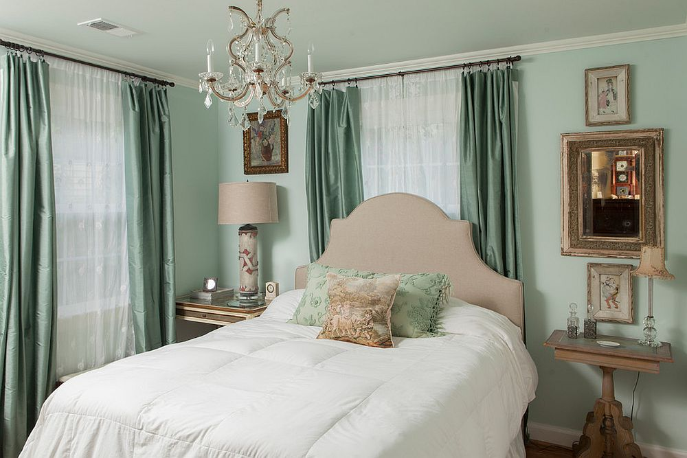 White sheers combined with dark gray drapes in the traditional bedroom